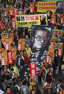 Manifestación por su libertad, en Hong Kong. | Efe