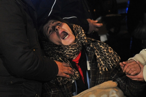 La madre de los cuatro niños fallecidos en el incendio de Roma. | AFP