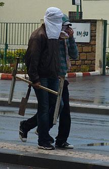 Manifestantes encapuchados. | E.C.