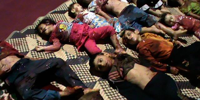 Cuerpos de varios de los 32 niños muertos en el ataque. | Reuters