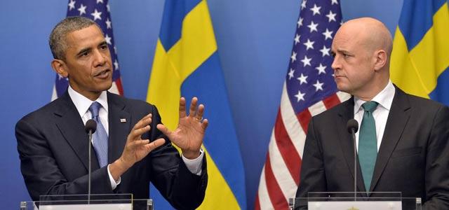 El presidente Obama junto al 'premier' sueco en una rueda de prensa en Estocolmo. | Afp