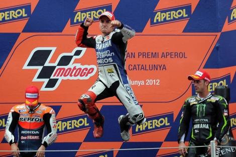 Jorge Lorenzo, en el podio, junto a Pedrosa (izda.) y Dovizioso. (EFE)